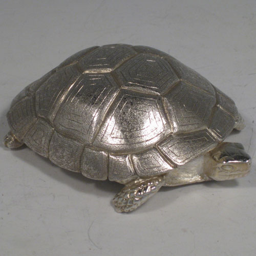 Sterling silver hand-made cast model of a tortoise, hallmarked for London 2008. Length 10 cms (4 inches), width 7.5 cms (3 inches). Weight approx. 9 troy ounces (280g).