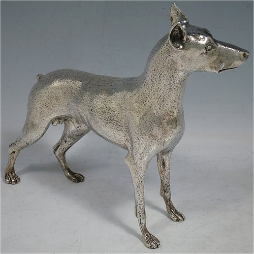 A large cast 800 Standard Silver model of a Doberman Pinscher dog, having a realistically hand-chased body. Made in Europe in ca. 1930. The dimensions of this fine hand-made 800 standard silver Doberman Pinscher dog model are height 17 cms (6.75 inches), length 19 cms (7.5 inches), width 5 cms (2.5 inches), and it weighs approx. 430g (13.9 troy ounces).