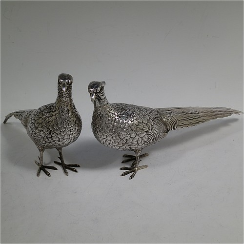A very handsome pair of Dutch Continental 833 standard Silver pheasants, showing a male and female bird in realistic traditional poses, finely detailed with hand-chased bodies and tail feathers, and with removable heads. Made in Holland in 1948. The dimensions of these fine hand-made silver pheasants are length of male bird 26 cms (10.25 inches), height 12.5 cms (5 inches), and they weigh a total approx. 413g (13.3 troy ounces).