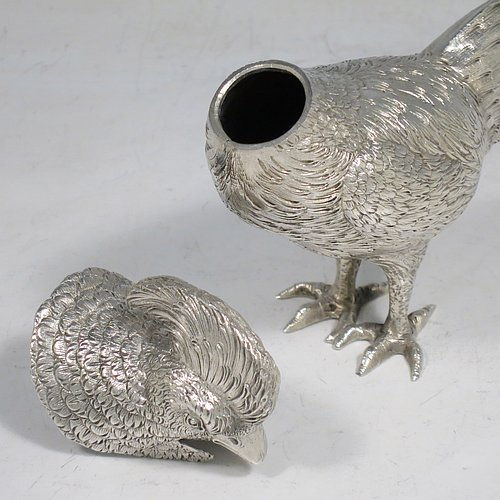 An Antique Edwardian Sterling Silver model of a King Pheasant bird, having realistically hand-chased feathers, a pull-off head, and cast feet. Made in ca. 1900 and imported from Continental Europe. The dimensions of this fine hand-made antique silver King Pheasant bird model are height 11.5 cms (4.5 inches), length 21 cms (8 inches), width 5 cms (2 inches), and it weighs approx. 175g (5.6 troy ounces).