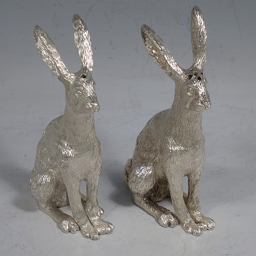 A cast Sterling Silver pair of hares, showing two  male hares in realistic traditional poses, finely detailed with hand-chased bodies, made hollow for use as salt and pepper shakers. Made by William Comyns of London in 2016. The dimensions of these fine hand-made sterling silver hare model salt and pepper shakers are length 5 cms (2 inches), height 8.5 cms (3.3 inches), and they weigh a total approx. 230g (7.4 troy ounces).