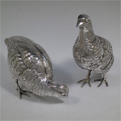 A very handsome and large pair of Antique Edwardian Silver-Plated partridge bird models, having realistically hand-chased feathers, faces, and feet. Made in ca. 1910 in England. The dimensions of this fine hand-made antique silver plated pair of partridge model birds are height 16.5 cms (6.5 inches), length 19 cms (7.5 inches), and width 7.5 cms (3 inches).