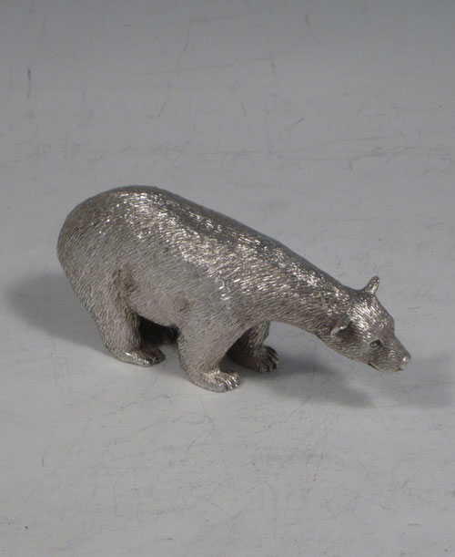 Sterling silver cast model of a standing polar bear, having realistically hand-chased fur, with fine detail. Made by Robert Comyns of London in 1989. The dimensions of this fine hand-made silver polar bear are length 9 cms (3.5 inches), height 4.5 cms (1.75 inches), and it weighs approx. 160g (5.2 troy ounces).