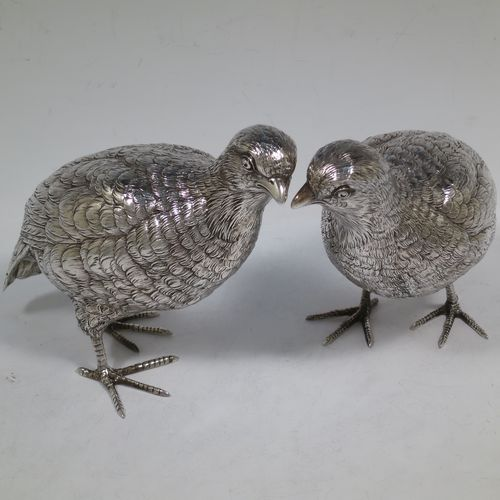 A very handsome and large pair of Sterling Silver partridge bird models, having realistically hand-chased feathers, faces, and feet. Bearing Import marks for London 1934. The dimensions of this fine hand-made sterling silver pair of partridge model birds are height 14 cms (5.5 inches), length 20 cms (8 inches), width 8 cms (3 inches), and they weigh a total of approx. 753g (24 troy ounces).