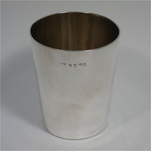A very handsome Antique Georgian Sterling Silver beaker cup, having a very plain round body with tapering sides, sitting on a flat base, and with a gold-gilt interior. Made by Philip Batchelor (poss.) of London in 1789. The dimensions of this fine hand-made antique silver beaker cup are height 9 cms (3.5 inches), diameter at top 7.5 cms (3 inches), and it weighs approx. 116g (3.7 troy ounces).