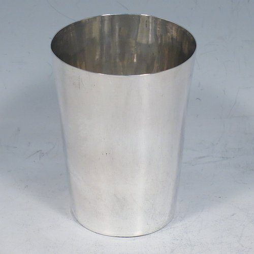 An Antique Georgian Sterling Silver beaker cup, having a very plain round body with tapering sides, and sitting on a flat base. Made by Samuel Godbehere, Edward Wigan & James Boult of London in 1811. The dimensions of this fine hand-made antique silver beaker cup are height 8 cms (3 inches), diameter at top 6 cms (2.25 inches), and it weighs approx. 90g (3 troy ounces).