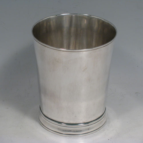 Antique Georgian sterling silver beaker, having a very plain round body with tapering sides, a reeded top border, and sitting on a collet foot. Made by Henry Chawner of London in 1787. The dimensions of this fine hand-made silver beaker are height 9.5 cms (3.75 inches), diameter at top 8 cms (3 inches), and it weighs approx. 152g (4.9 troy ounces).