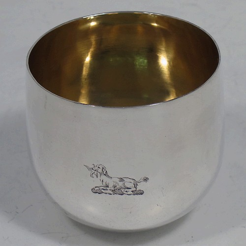 A very handsome and rare Antique Georgian Sterling Silver tumbler cup, having a plain round body, with a gold-gilt interior. Made in London in 1768. The dimensions of this fine hand-made antique silver tumbler cup are height 5.5 cms (2.25 inches), diameter 6 cms (2.25 inches), and it weighs approx. 74g (2.4 troy ounces). Please note that this item is crested.