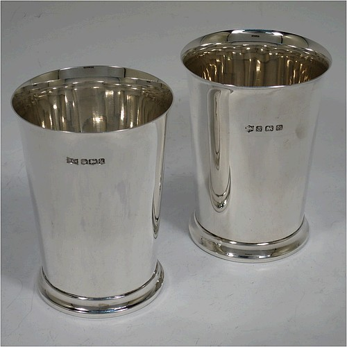 A very handsome Sterling Silver pair of beaker cups, having plain round bodies with tapering sides, and sitting on a collet foot with a reeded border. Made by S. Blanckensee and Sons of Birmingham in 1926/28. The dimensions of this fine pair of hand-made silver beakers are height 10 cms (4 inches), diameter at top 7.5 cms (3 inches), and they weigh a total of approx. 333g (10.7 troy ounces).