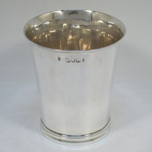 A very handsome Antique Victorian Sterling Silver beaker cup, having a very plain round body with tapering sides, and sitting on a collet foot with reeded decoration. Made by Walter and Harold Child of London in 1898. The dimensions of this fine hand-made antique silver beaker cup are height 9.5 cms (3.75 inches), diameter at top 8.5 cms (3.3 inches), and it weighs approx. 134g (4.3 troy ounces).