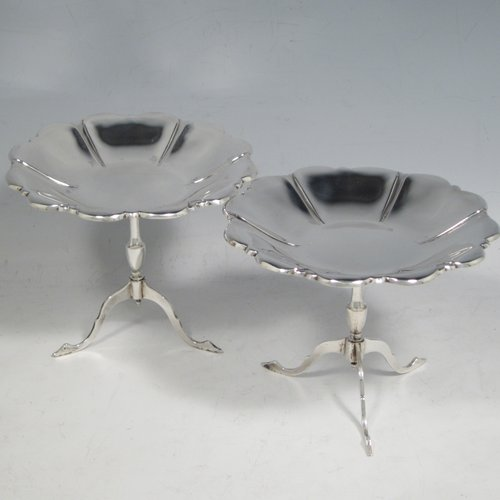 Antique Edwardian sterling silver pair of very pretty pedestal table style bon-bon dishes, having round lobed bodies, and each sitting on three feet. Made by Roberts and Belk of Sheffield in 1908. The dimensions of this fine pair of hand-made silver bon-bon dishes are diameter 12 cms (4.75 inches), height 9.5 cms (3.75 inches), and they weigh a total of 163g (5.3 troy ounces).