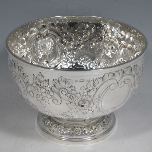 Antique Edwardian sterling silver rose bowl, having a round body with hand-chased floral decoration, two vacant cartouches, and sitting on a pedestal foot. Made by Elkington and Co., of Birmingham in 1903. The dimensions of this fine hand-made silver rose bowl are height 11 cms (4.25 inches), diameter 15 cms (6 inches), and the total weight is approx. 326g (10.5 troy ounces).