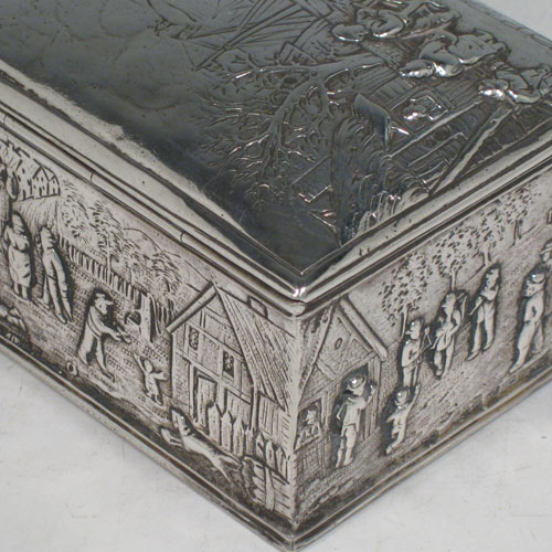 Antique Edwardian sterling silver table box, having a rectangular body, with hinged lid, gold-gilt interior, hand-chased decoration showing various pastoral scenes with each panel having a different view, and sitting on a flat base. Originally Dutch in origin and imported into London in 1904 with a sponsors mark for John George Piddington. Length 10.5 cms (4.25 inches), height 6.5 cms (2.5 inches), width 8 cms (3 inches). Weight approx. 242g (7.8 troy ounces)