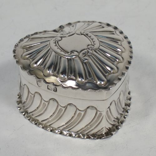 A very pretty Antique Victorian Sterling Silver heart-shaped table box, having a gold-gilt interior, all hand-chased with scroll-work, a hinged lid with vacant cartouche, and all sitting on a flat base. Made by Streeter and Co. Ltd., of London in 1899. The dimensions of this fine hand-made antique silver box are length 6 cms (2.3 inches), width 6 cms (2.3 inches), height 4 cms (1.5 inches), and it weighs approx. 49g (1.6 troy ounces).