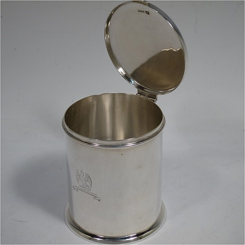 A very handsome Sterling Silver table box, having a round and straight-sided body with a hinged and slightly domed lid, with applied reed borders and thumb-piece, and sitting on a collet foot. Made by Ollivant and Bottisford of Sheffield in 1931. The dimensions of this fine hand-made silver box are diameter 8 cms (3 inches), height 9 cms (3.5 inches), and it weighs approx. 276g (8.9 troy ounces). Please note that this item is crested.