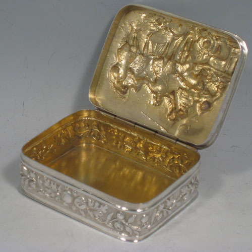 Antique Edwardian sterling silver table box, having a rectagular body, with a hand-chased hinged lid showing six soldiers in dress uniform in various poses, a gold-gilt interior, and a hand-chased freeze of floral work running around the sides, and sitting on a flat base. Originally Dutch in origin and imported into Chester in 1902 with a sponsors mark for Samuel Boyce Landec. The dimensions of this fine hand-made silver table box are length 9 cms (3.5 inches), height 3 cms (1.25 inches), width 7 cms (2.75 inches), and it weighs approx. 169g (5.5 troy ounces)