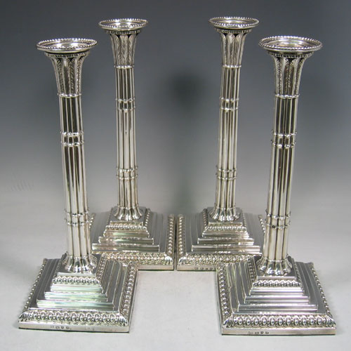 Antique Georgian sterling silver set of four candlesticks made by John Cafe of London in 1770. Height 31.5 cms.