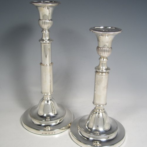 Antique Georgian sterling silver pair of rare telescopic candlesticks, having round baluster bases and plain straight-sided collumns, with gadroon borders, and removable nozzles. Made by George Ashford & Co., of Sheffield in 1804. The dimensions of these fine hand-made silver candlesticks are height 25 cms (9.75 inches), and when extended 30 cms (11.75 inches), and base 13.5 cms (5.25 inches) diameter.