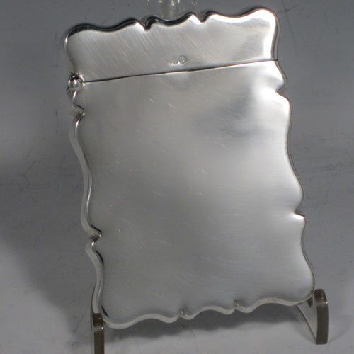 Sterling silver calling card case, having a plain shaped rectangular body, a side-hinged lid, and a gold-gilt interior. Made by Robert Pringle of Birmingham in 1915. The dimensions of this fine hand-made silver card case are length 9 cms (3.5 inches), width 7 cms (2.75 inches), and it weighs approx. 57g (1.8 troy ounces).