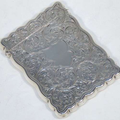 A very elegant Antique Victorian Sterling Silver calling card case, having a shaped rectangular body with hand-engraved floral and scroll decoration, a gold-gilt interior, a vacant central cartouche on one side, and a side-hinged lid. Made by Walker and Hall of Birmingham in 1900. The dimensions of this fine hand-made antique silver card case are length 9.5 cms (3.75 inches), width 7 cms (2.75 inches), and it weighs approx. 74g (2.4 troy ounces).