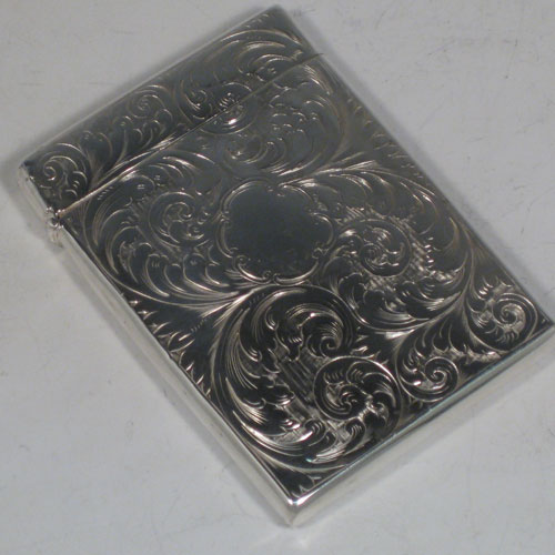 Antique Victorian sterling silver calling card case, having a rectangular body with hand-engraved floral decoration, and a side-hinged lid. Made by Francis Clark of Birmingham in 1847. The dimensions of this fine hand-made silver card case are length 9.5 cms (3.75 inches), width 7 cms (2.75 inches), and it weighs approx. 82g (2.6 troy ounces).