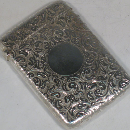 Antique Victorian sterling silver calling card case, having a rectangular body with hand-engraved floral decoration, a vacant central cartouch, and a side-hinged lid. Made in  Birmingham in 1889. The dimensions of this fine hand-made silver card case are length 10 cms (4 inches), width 7 cms (2.75 inches), and it weighs approx. 61g (2 troy ounces). Please note that this card case has a push button mechanism that is not working, but it is not required to make the lid secure.