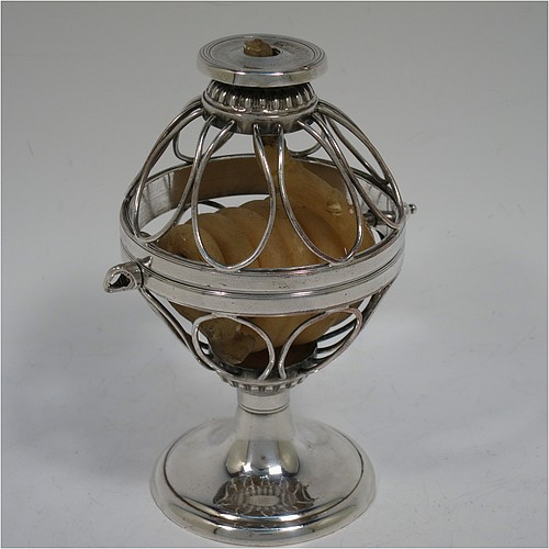 An Antique Georgian Old Sheffield Silver Plated wax-jack chamber-stick in a globe style, having a coiled wax mounted in a spherical boy with a wire-work frame, sitting on a plain round pedestal foot, with hand-chased reeded borders, all in original condition. Made in ca. 1800. The dimensions of this fine hand-made antique Old Sheffield silver-plated waxjack chamberstick are height 13.5 cms (5.5 inches), and diameter 7.5 cms (3 inches).