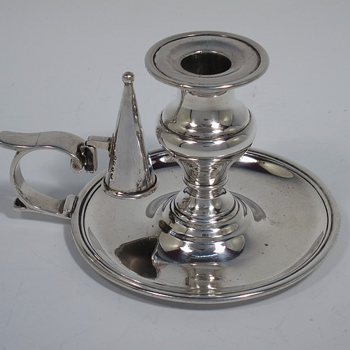 An Antique Victorian Sterling Silver small chamber-stick, having a plain body with a round base, a cast plain scroll handle, an original removable dunce-cap extinguisher, an original removable nozzle, and with applied reed-edged borders. Made by Samuel Hayne and Dudley Cater of London in 1850. The dimensions of this fine hand-made antique silver chamberstick are diameter 10 cms (4 inches), height 7 cms (2.75 inches), and it weighs approx. 179g (5.8 troy ounces).