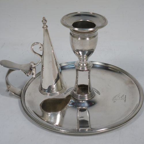 A handsome Antique Georgian Sterling Silver chamber-stick, having a round base, a cast plain scroll handle, an original removable dunce-cap extinguisher, an original removable nozzle, and with applied reed-edged borders. Made by John Emes of London in 1792. The dimensions of this fine hand-made antique silver chamberstick are diameter 14 cms (5.5 inches), height 10 cms (4 inches), and it weighs approx. 300g (9.7 troy ounces).