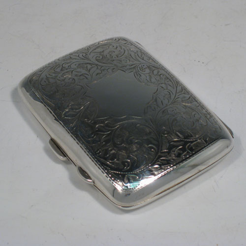 Sterling silver cigarello / cigarette case, having a rectangular shaped body with hand-engraved floral decoration, thumb-piece with catch, and gold-gilt interior. Length 8 cms (3.25 inches), width 6 cms (2.3 cms). Weight approx. 65g (2 troy ounces).