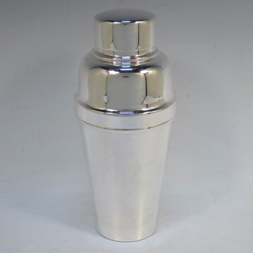 A handsome Silver-Plated Art Deco cocktail shaker, having a plain round body with tapering sides, with a pull-off lid and strainer section. Made by Roberts and Dore of Sheffield in ca. 1930. The dimensions of this fine hand-made silver plated cocktail shaker are height 20 cms (8 inches), diameter at widest point 9 cms (3.5 inches).