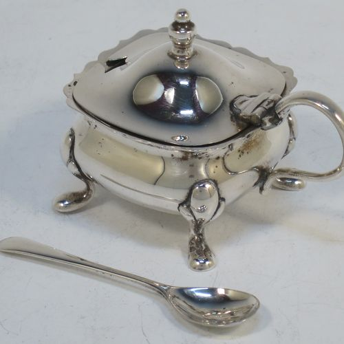 A pretty Sterling Silver three-piece condiment set in a traditional style with Chippendale borders, consisting of an open salt cellar with a blue glass liner, a pepper pot with pull-off lid, a mustard pot with blue glass liner and hinged lid, together with two original condiment spoons, and all in their cream satin and black velvet-lined presentation box. Made by William Suckling of Birmingham in 1955. The dimensions of this fine hand-made silver condiment service are length of mustard pot 7.5 cms (3 inches), height of pepper pot 8 cms (3 inches), width of salt cellar 5 cms (2 inches), and with a total weight of approx. 136g (4.4 troy ounces).