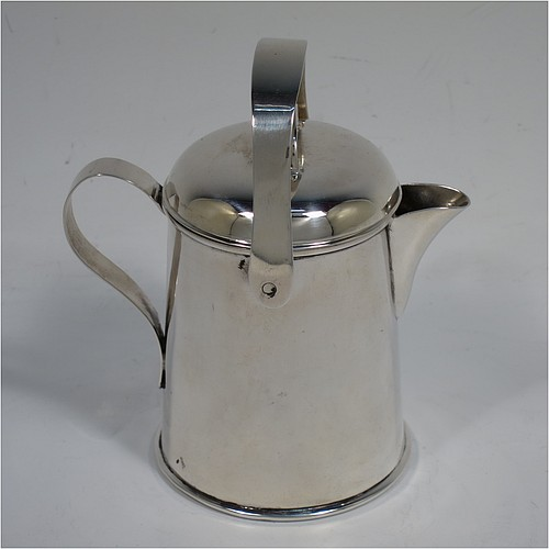 A very unusual Antique Edwardian Sterling Silver cream jug, in a plain watering jug style, with a round straight-sided body, a loop handle and sparrow-beak spout, a lift-off lid with swing-handle, and all sitting on a collet foot. Made by Jones & Crompton of Birmingham in 1902. The dimensions of this fine hand-made antique silver cream jug are height (inc. swing-handle) 10 cms (4 inches), length 9 cms (3.5 inches), and it weighs approx. 93g (3 troy ounces).