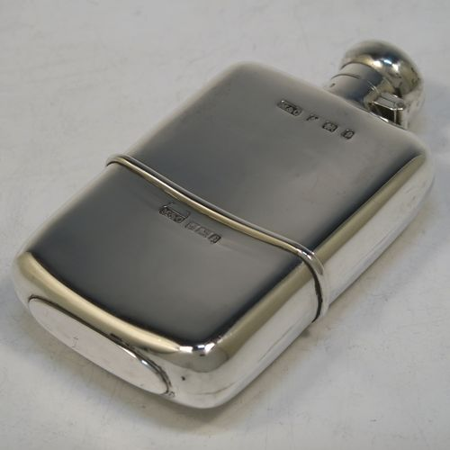 A very handsome Antique Edwardian Sterling Silver whisky hip flask, having a plain shaped rectangular body with rounded shoulders, a bayonet-fit lid, and a pull-off cup. Made by Marks and Cohen of Birmingham in 1905. The dimensions of this fine hand-made antique silver whisky flask are length 11.5 cms (4.5 inches), width 6 cms (2.3 inches), depth 2 cms (0.75 inch), and it weighs approx. 135g (4.4 troy ounces).