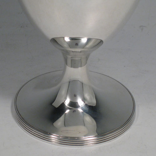 A handsome Antique Victorian Sterling Silver goblet, having a plain round body, sitting on a pedestal foot with a reeded border. Made by Hawksworth, Eyre and Co., of Sheffield in 1853. The dimensions of this fine hand-made antique silver goblet are height 15 cms (6 inches), diameter at lip 9 cms (3.5 inches), and it weighs approx. 197g (6.4 troy ounces).