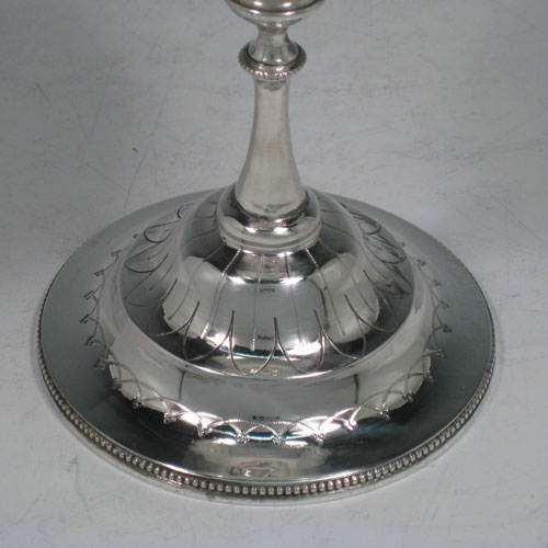 Antique Victorian sterling silver large wine goblet, having a round body with hand-engraved decoration, a gold-gilt interior, and sitting on a pedestal foot with a bead border. Made by Henry Holland of London in 1872. The dimensions of this fine hand-made silver goblet are height 22.5 cms (8.75 inches), diameter at lip 10 cms (4 inches), and it weighs approx. 303g (9.8 troy ounces).
