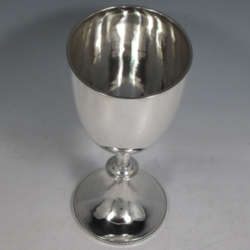 Antique Edwardian sterling silver, having a plain round tapering body, and sitting on a pedestal foot with an applied bead border. Made by Goldsmiths and Silversmiths of London in 1903. The dimensions of this fine hand-made silver goblet are height 20 cms (8 inches), diameter at lip 9 cms (3.5 inches), and it weighs approx. 208g (6.7 troy ounces).