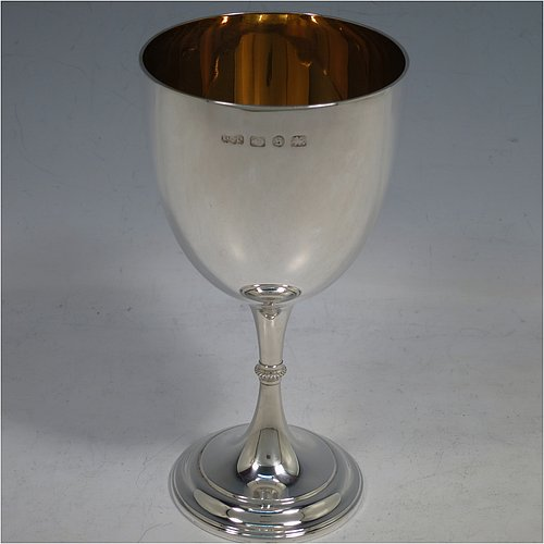 An Antique Victorian Sterling Silver goblet, having a plain round tapering body, and sitting on a pedestal foot with an applied beaded band, and a gold-gilt interior. Made by Elkington & Co., of Birmingham in 1892. The dimensions of this fine hand-made antique silver goblet are height 16.5 cms (6.5 inches), diameter at lip 8.5 cms (3.3 inches), and it weighs approx. 153g (5 troy ounces).