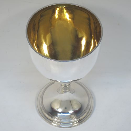 A very handsome Antique Victorian Sterling Silver goblet, having a plain round body with a gold-gilt interior, and sitting on a pedestal foot with hand-chased reeded decoration. Made by Francis Boone Thomas of London in 1893. The dimensions of this fine hand-made antique silver goblet are height 18 cms (7 inches), diameter at lip 10 cms (4 inches), and it weighs approx. 226g (7.3 troy ounces).