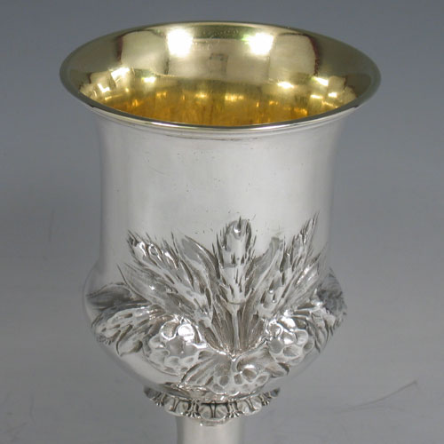 Antique Victorian sterling silver goblet, having a round campagna style body with hand-chased wheat-sheaf decoration, a gold-gilt interior, and sitting on a pedestal foot. Made by George and Charles Fox of London in 1845. The dimensions of this fine hand-made silver goblet are height 15 cms (6 inches), diameter at lip 9 cms (3.5 inches), and it weighs approx. 170g (5.5 troy ounces).
