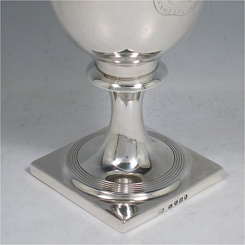 An Antique Georgian Sterling Silver heavy goblet, having a plain round tapering body, and sitting on a pedestal foot with reeded decoration and a square base. Made by Thomas Hayyer of London in 1811. The dimensions of this fine hand-made antique silver goblet are height 17 cms (6.3 inches), diameter at lip 9 cms (3.5 inches), and it weighs approx. 372g (12 troy ounces). Please note that this item is crested.