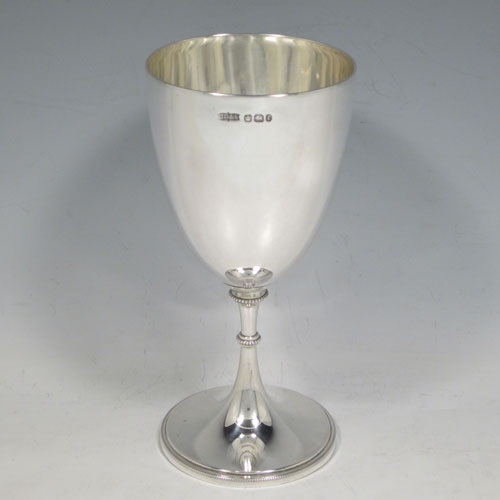 A pretty Antique Victorian Sterling Silver goblet, having a plain round tapering body, and sitting on a pedestal foot with an applied bead border. Made by James Dixon and Sons of Sheffield in 1895. The dimensions of this fine hand-made antique silver goblet are height 17 cms (6.75 inches), diameter at lip 8 cms (3 inches), and it weighs approx. 186g (6 troy ounces).