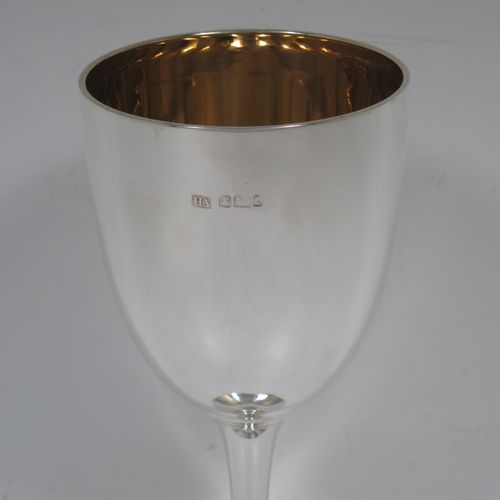 A handsome Antique Edwardian Sterling Silver goblet, having a plain round tapering body, and sitting on a pedestal foot with an applied bead-edged border, and a gold-gilt interior. Made by Henry Atkins of Sheffield in 1903. The dimensions of this fine hand-made antique silver goblet are height 17.5 cms (6.75 inches), diameter at lip 8 cms (3 inches), and it weighs approx. 147g (4.7 troy ounces).