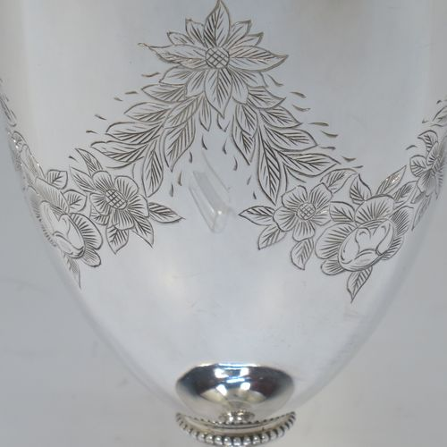 A very pretty Antique Victorian Sterling Silver goblet, having a round bellied body with hand-engraved swags of floral decoration, a gold-gilt interior, and sitting on a pedestal foot with an applied bead-edged border. Made by James Dixon and Sons of Sheffield in 1877. The dimensions of this fine hand-made antique silver goblet are height 18 cms (7 inches), diameter at lip 8.5 cms (3.3 inches), and it weighs approx. 224g (7.2 troy ounces).