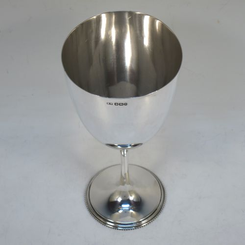 A handsome Antique Victorian Sterling Silver goblet, having a plain round tapering body, and sitting on a plain pedestal foot with an applied bead border. Made by Henry Wilkinson of Sheffield in 1900. The dimensions of this fine hand-made antique silver goblet are height 16.5 cms (6.5 inches), diameter at lip 8 cms (3.25 inches), and it weighs approx. 142g (4.6 troy ounces).