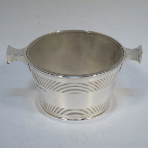 A very handsome Antique Victorian Sterling Silver and crystal honey, jam, or conserve jar, in the shape of a Quaich, having a plain round body with tapering sides and reeded decoration, two side handles, and with a frosted cut crystal insert with a star-cut base. Made by Martin Hall and Co., of Sheffield in 1896. The dimensions of this fine hand-made silver and crystal Quaich style conserve, jam, or honey jar are height 6 cms (5.5 inches), diameter 10 cms (4 inches), and it weighs approx. 235g (7.6 troy ounces).
