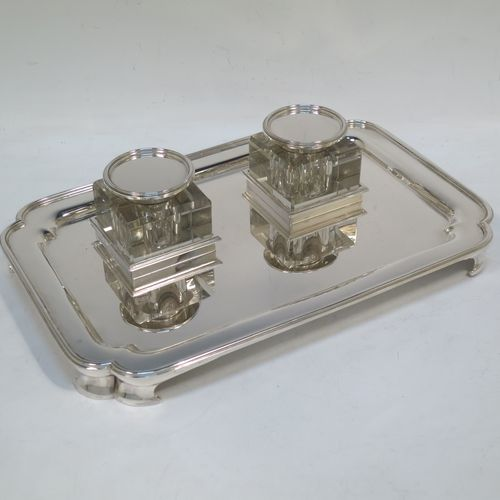 A very elegant and large Sterling Silver heavy table inkstand, having a plain rectangular body, with cut corners, two removable square crystal ink-wells with hinged round silver lids, all sitting on four cast flange feet. Made by Henry H. Plante of London in 1963. The dimensions of this fine hand-made table inkstand are length 25.5 cms (10 inches), width 17 cms (6.75 inches), and it weighs a total of approx. 650g (21 troy ounces).