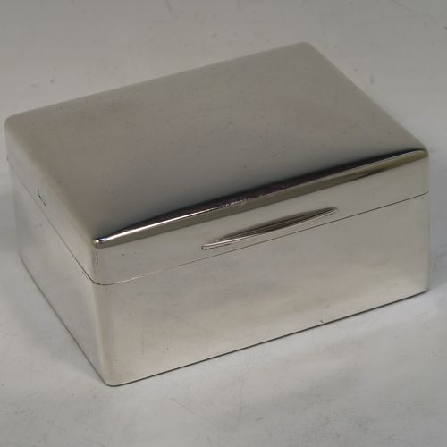 A very handsome Antique Sterling Silver jewelery box, having a very plain rectangular shaped body with straight sides and rounded corners, a hinged lid with an applied thumb-piece, and a maroon velvet-lined interior, and all sitting on a flat base. Made by Joseph Braham of London in 1911. The dimensions of this fine hand-made silver jewellery box are length 11cms (4.3 inches), width 9cms (3.5 inches), and height 5 cms (2 inches)