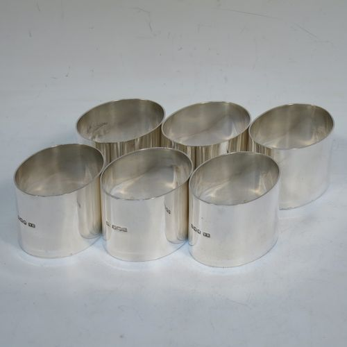 A very handsome set of six Sterling Silver napkin rings, having very plain oval shaped and straight-sided bodies. Made by Henry Atkins of Sheffield in 1928. The dimensions of this fine hand-made set of silver napkin rings are length 5 cms (2 inches), width 4 cms (1.5 inches), height 3.5 cms (1.3 inches), and they weigh a total of approx. 242g (7.8 troy ounces).