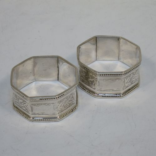 A pretty Antique Victorian Sterling Silver pair of napkin rings, having straight sided octagonal bodies with hand-engraved floral decoration, and with applied bead-edged borders. Made by Harry Hayes of Birmingham in 1900. The dimensions of these fine hand-made antique silver napkin rings are width 4.5 cms (1.75 inches), height 2.3 cms (0.75 inch), and they weigh a total of approx. 43g (1.4 troy ounces).